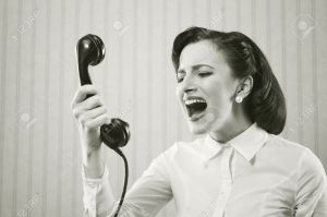 Young-Woman-shouting-into-telephone-Stock-Photo-angry-screaming